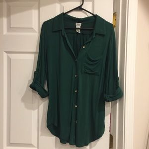 Emerald green button down blouse.